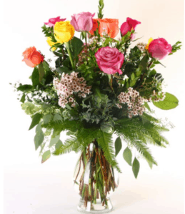 One dozen of the finest Ecuadorian roses carefully hand selected and arranged in all their natural beauty in a glass vase